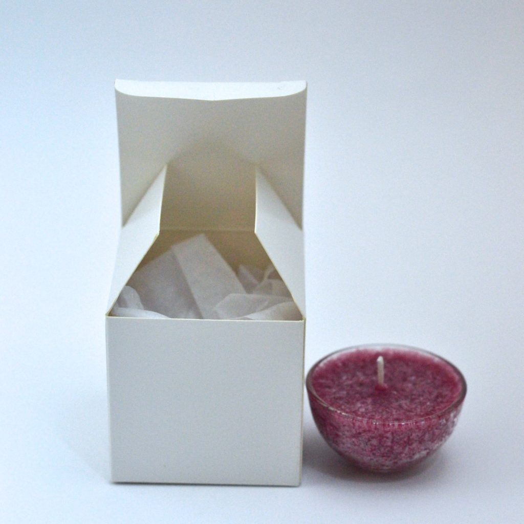 Single glass tealight in custom box with label